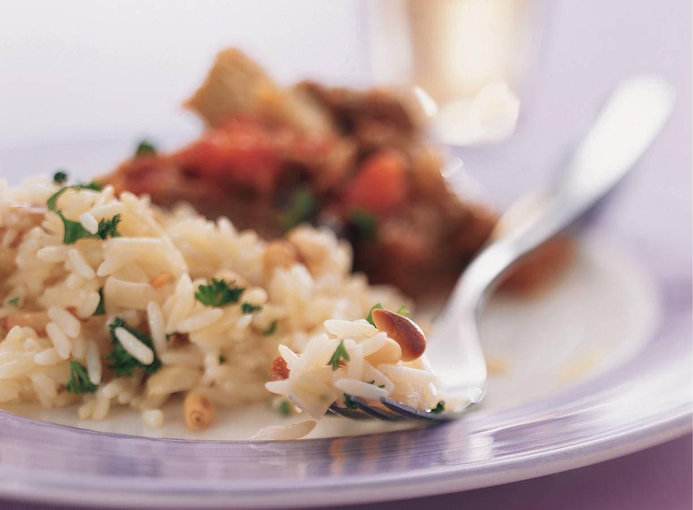 Witte rijst met sherry en pijnboompitten