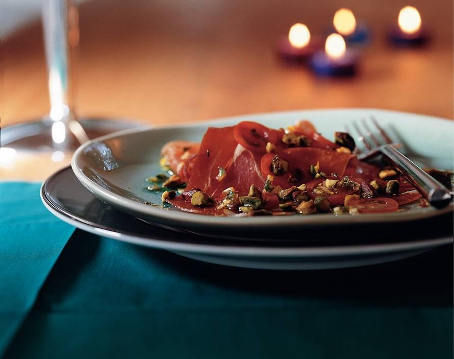 Carpaccio van serranoham en tomaat