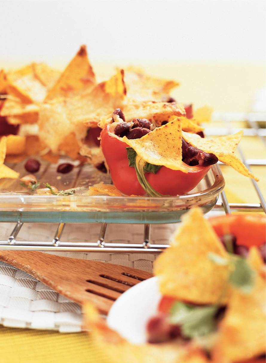 Mexicaanse paprika's met kidneybonen en tortilladeksel