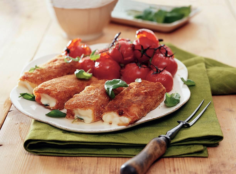 Kaasschnitzel met geroosterde tomaten