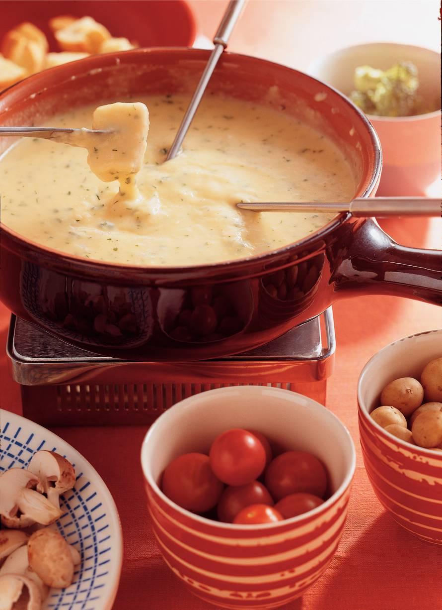 Kaasfondue met tuinkruiden en rauwkost
