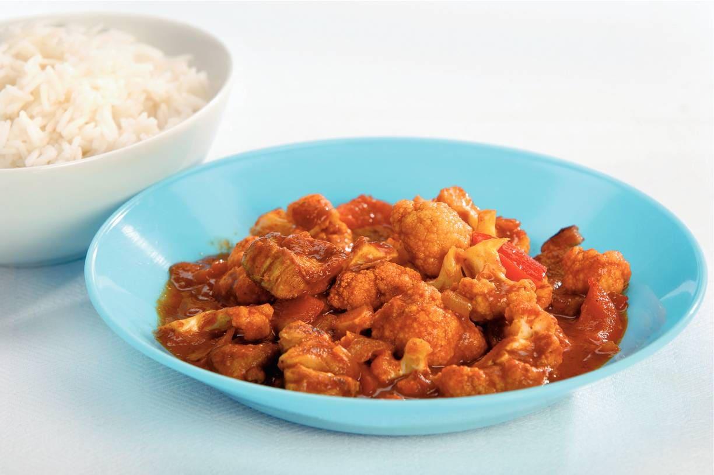 Indiase curry van karbonades met bloemkool