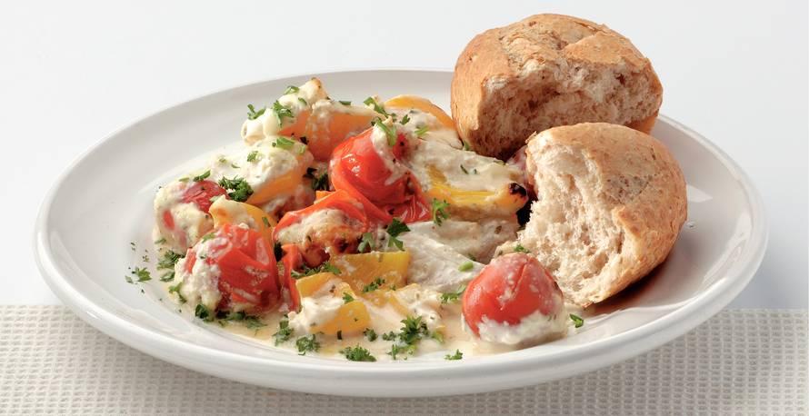Vis in knoflooksaus met tomaatjes