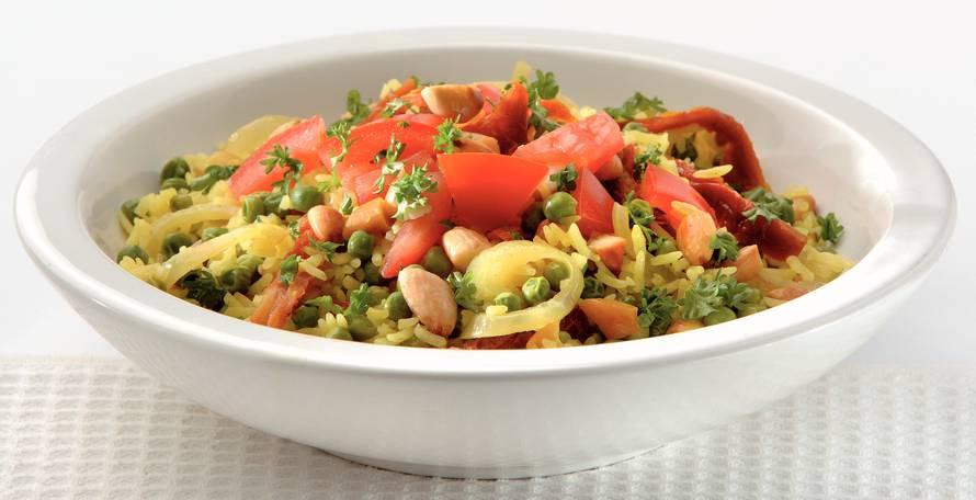 Vegetarische amandelpaella met gedroogde tomaten