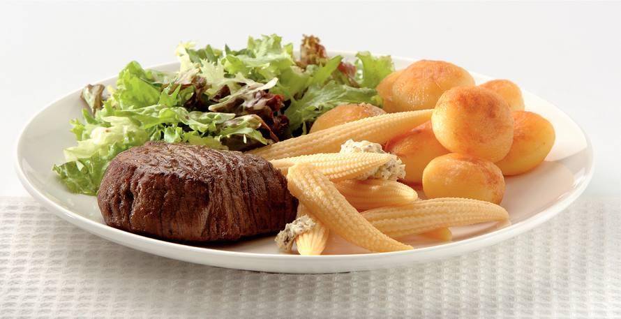 Pittige gegrilde biefstuk met maïs