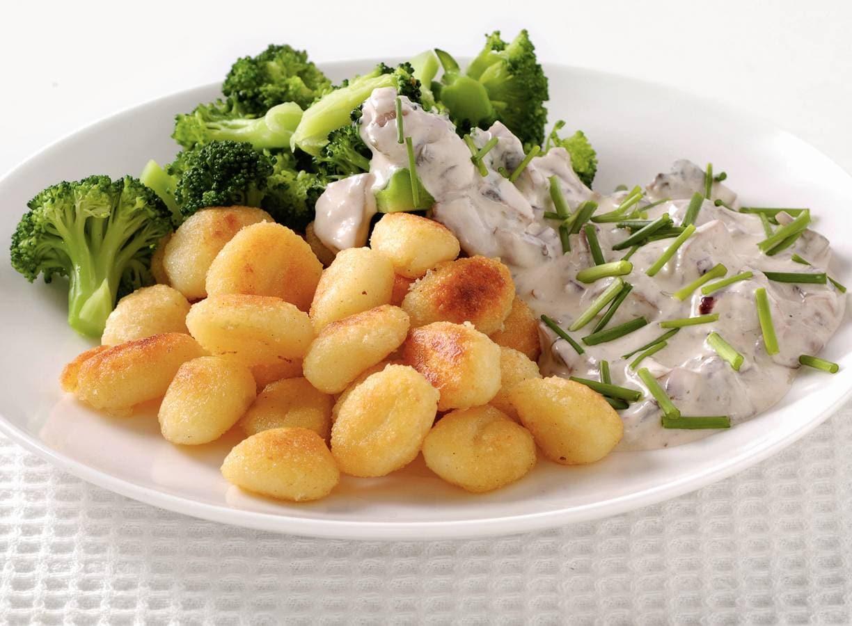 Gnocchi met champignonroomsaus en broccoli