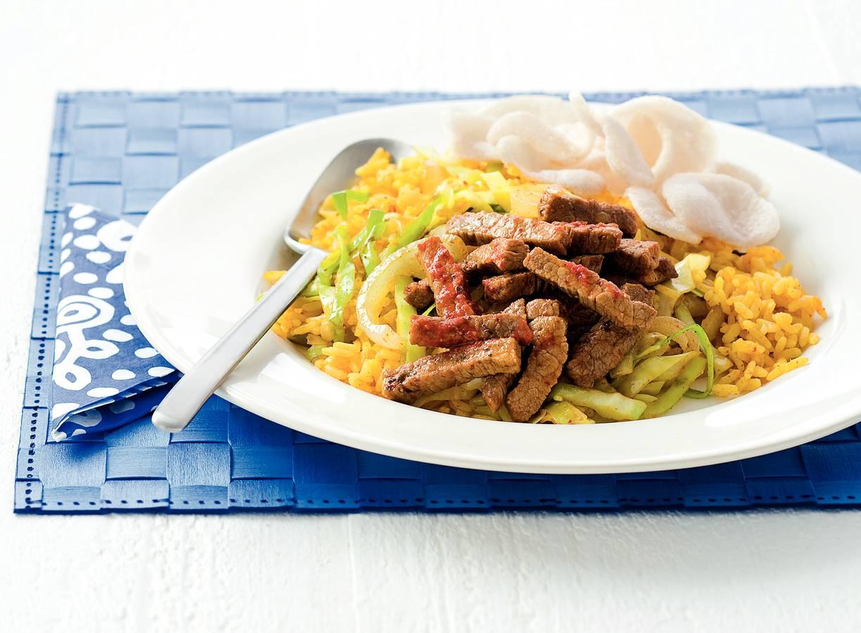 Pikante runderreepjes met gebakken rijst