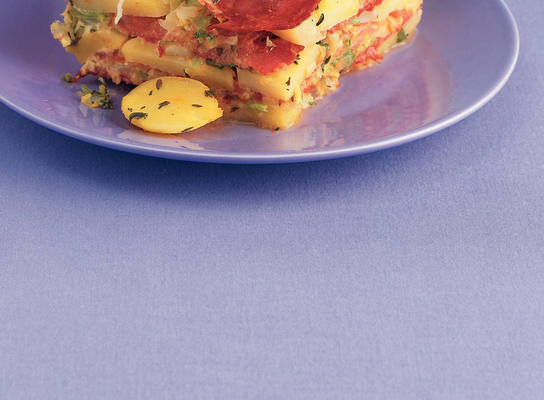 Aardappelschotel met chorizo en spitskool