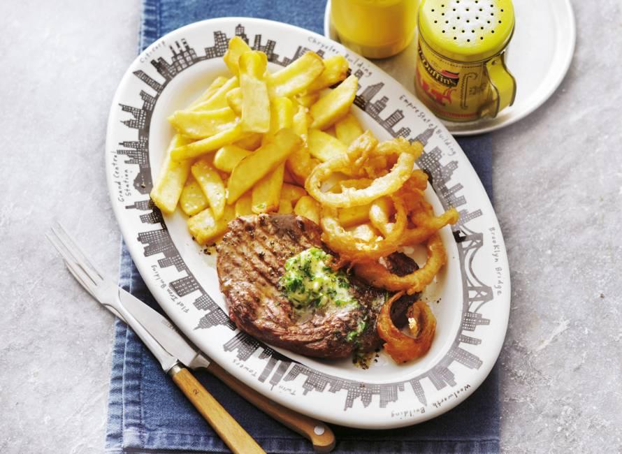 Steak met gefrituurde uienringen